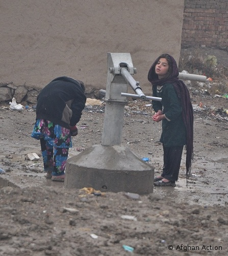 Refugees at water pump